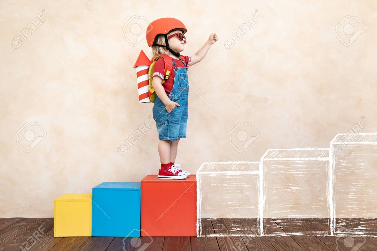 Kid with toy paper rocket. Child playing at home. Success, imagination and innovation technology concept - 126941297