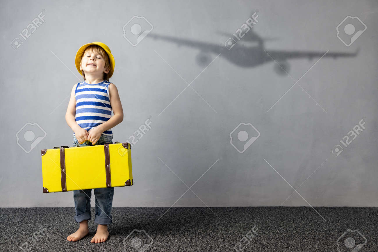 Happy child dreaming about travel. Summer vacation concept - 167649502