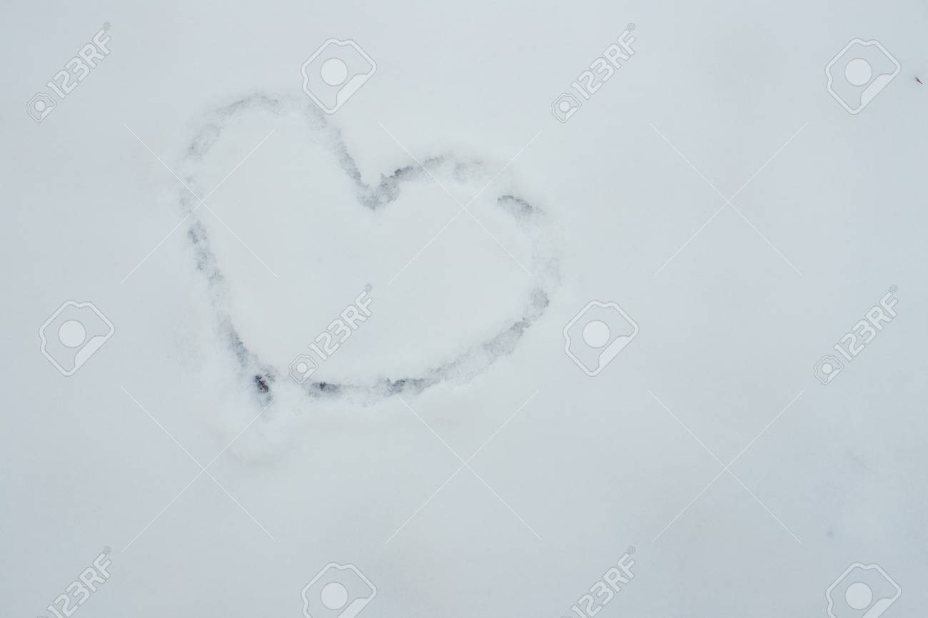 Flat lay of a snow heart lead, Love text symbol sign   Concept