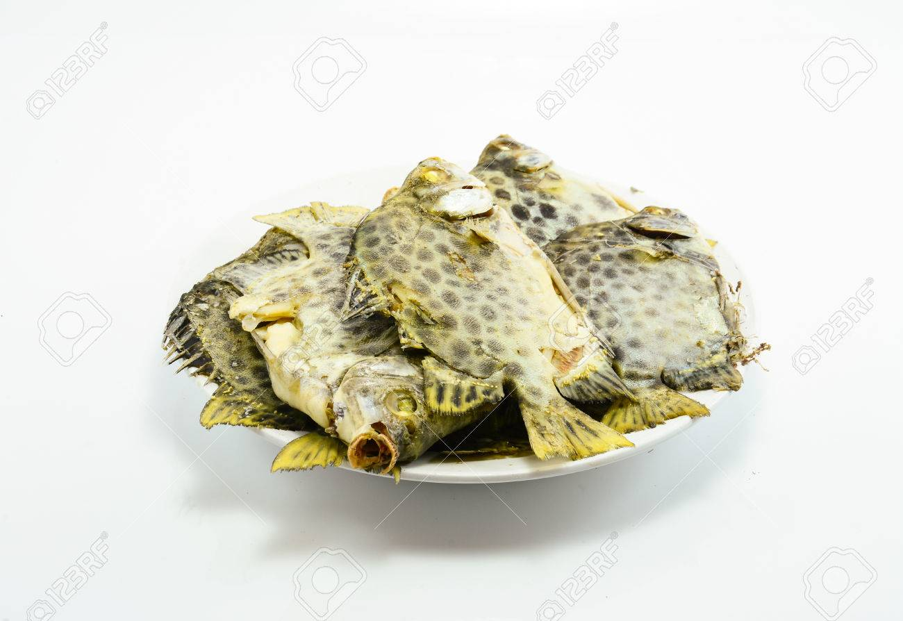 boiled  spotted scat,green scat ,thai food on white background Stock Photo - 27431146