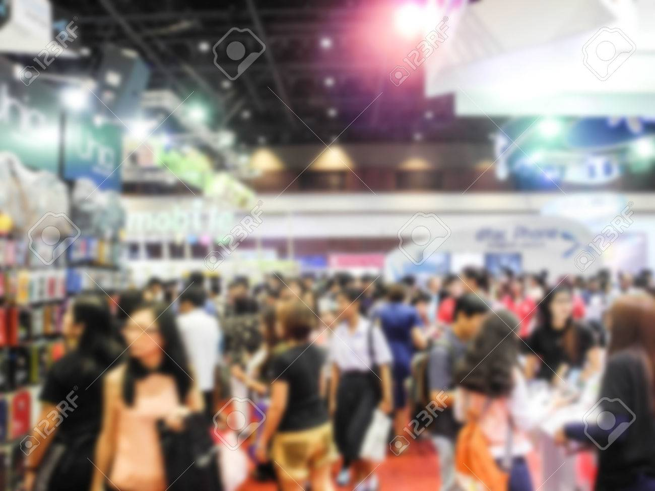 Abstract people walking in exhibition blurred background - 46695970