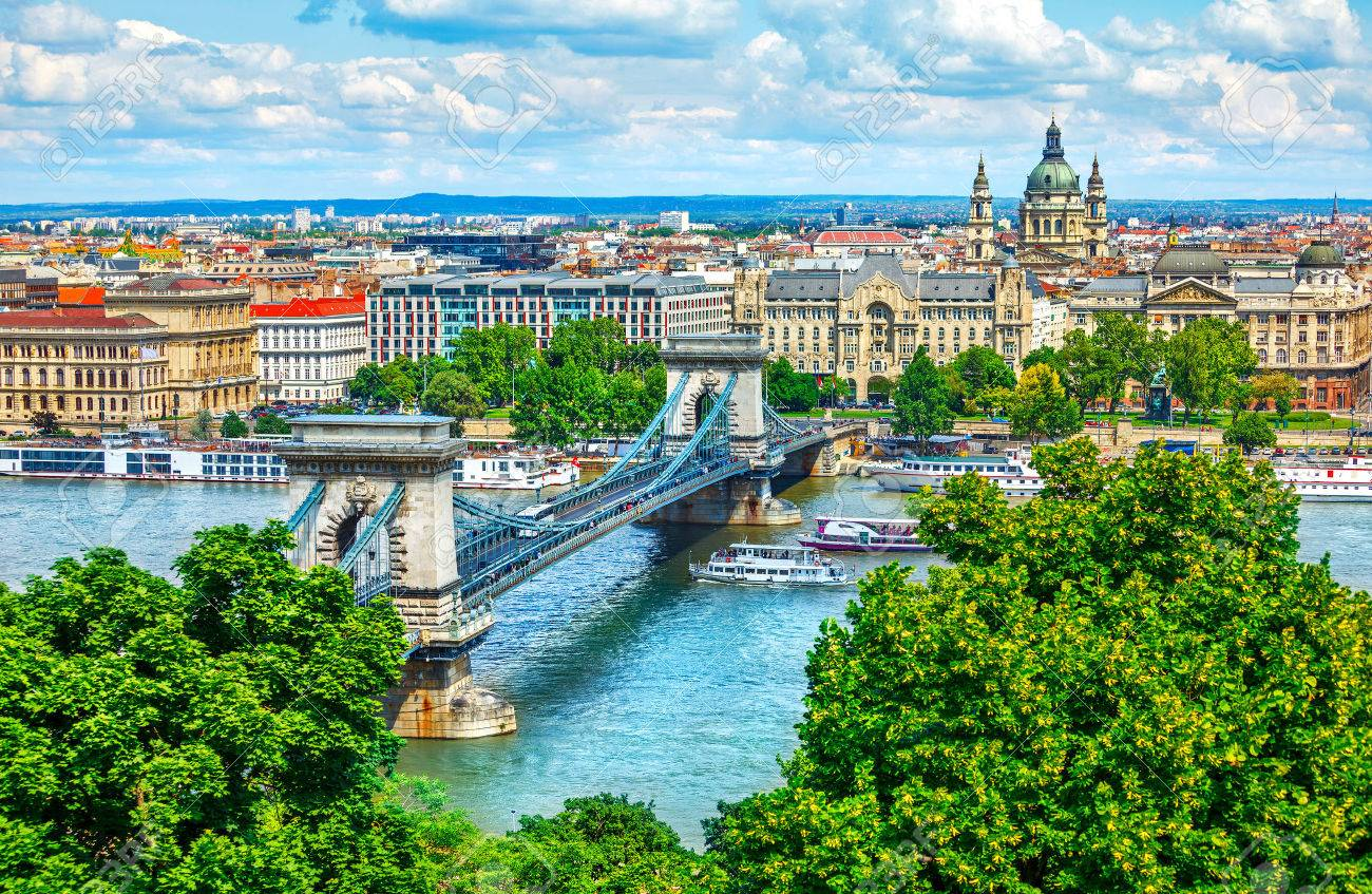 Chain bridge on Danube river in Budapest city, Hungary. Urban landscape panorama with old buildings and domes of opera buildings - 71425458