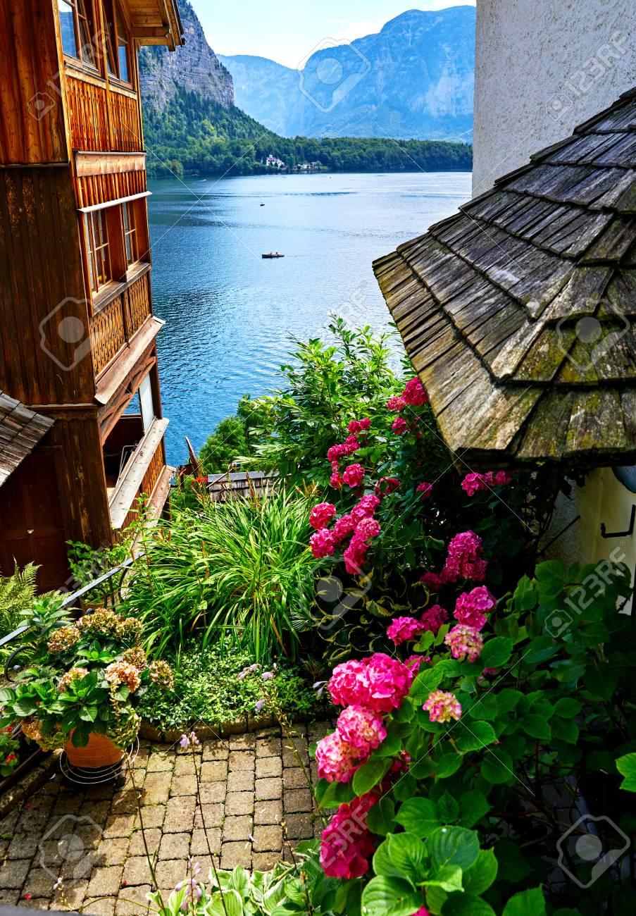 Hallstatt Austria Traditional Austrian Yard With Flowerpots Green Plants And Flowers Among Old
