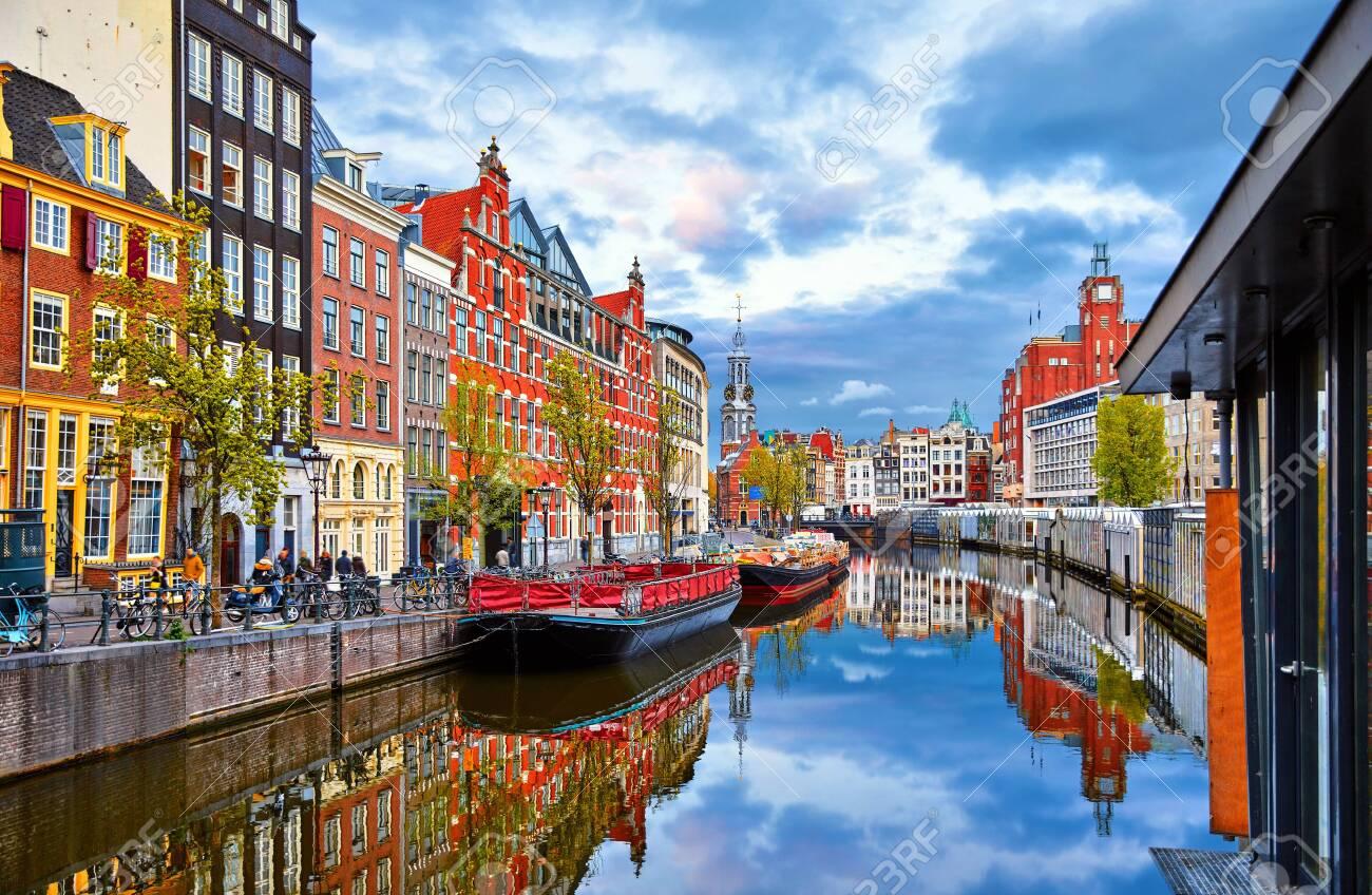 Channel in Amsterdam Netherlands houses river Amstel landmark old european city spring landscape. - 122012083