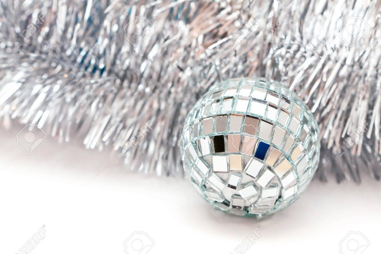 glass Christmas ball and a silver garland Stock Photo - 16882170