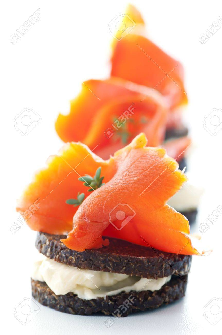 Tapas with salmon and bread slices Stock Photo - 12881334