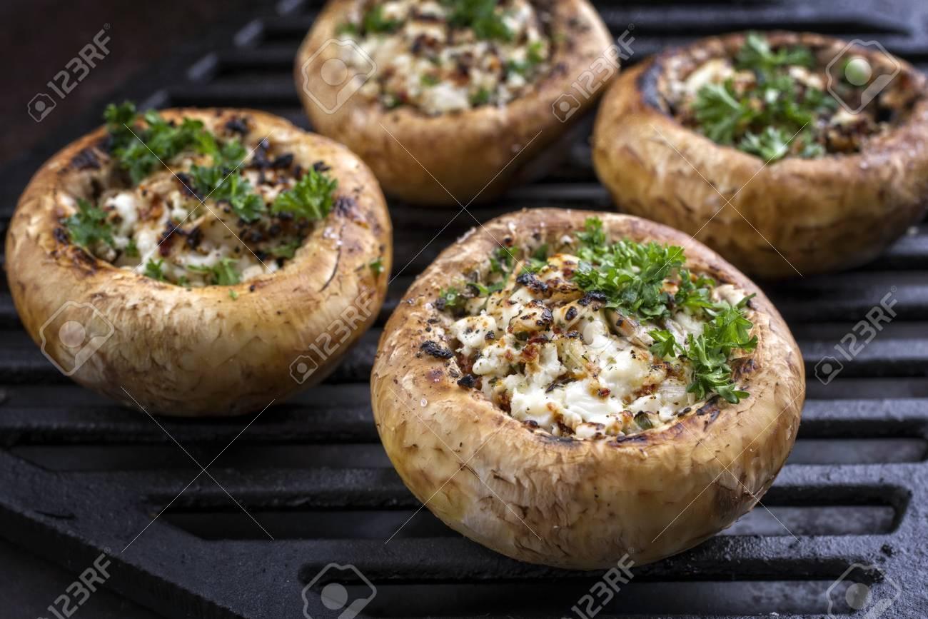 Traditional Italian Mushroom Caps stuffed with Feta as close-up on a grillage - 86469936