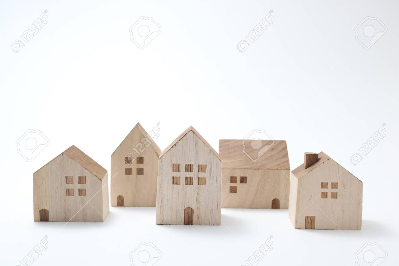 Sensational Miniature Houses On White Background Building Blocks Arranged Download Free Architecture Designs Scobabritishbridgeorg