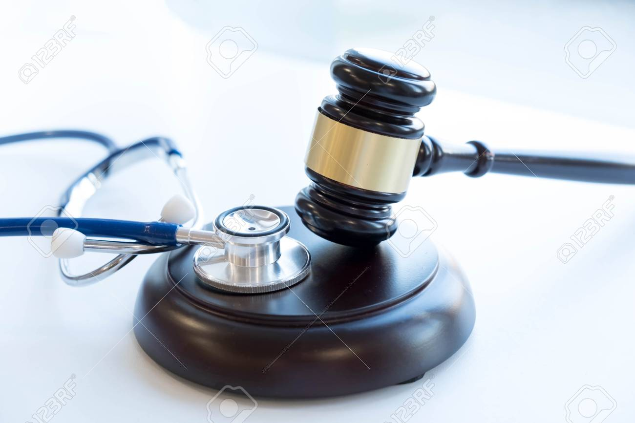 Gavel and stethoscope. medical jurisprudence. legal definition of medical malpractice. attorney. common errors doctors, nurses and hospitals make. - 89759310