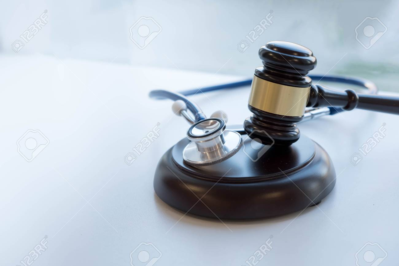 Gavel and stethoscope. medical jurisprudence. legal definition of medical malpractice. attorney. common errors doctors, nurses and hospitals make. - 91168245