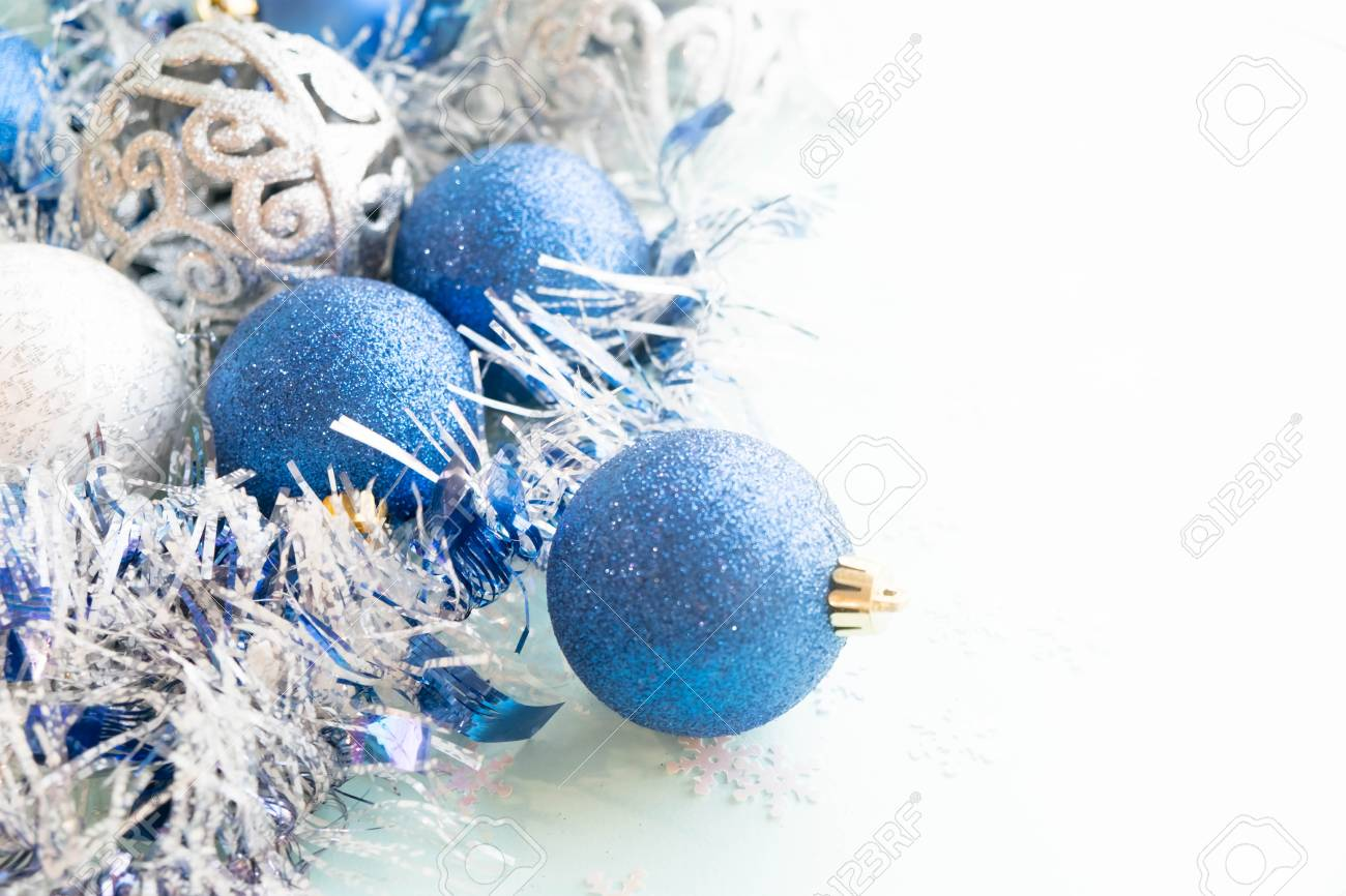 White Christmas Ornaments On Light Blue Background With Colorful