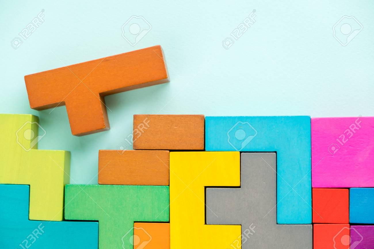 Different colorful shapes wooden blocks on beige background, flat lay. Geometric shapes in different colors, top view. Concept of creative, logical thinking or problem solving. Copy space. - 95586093