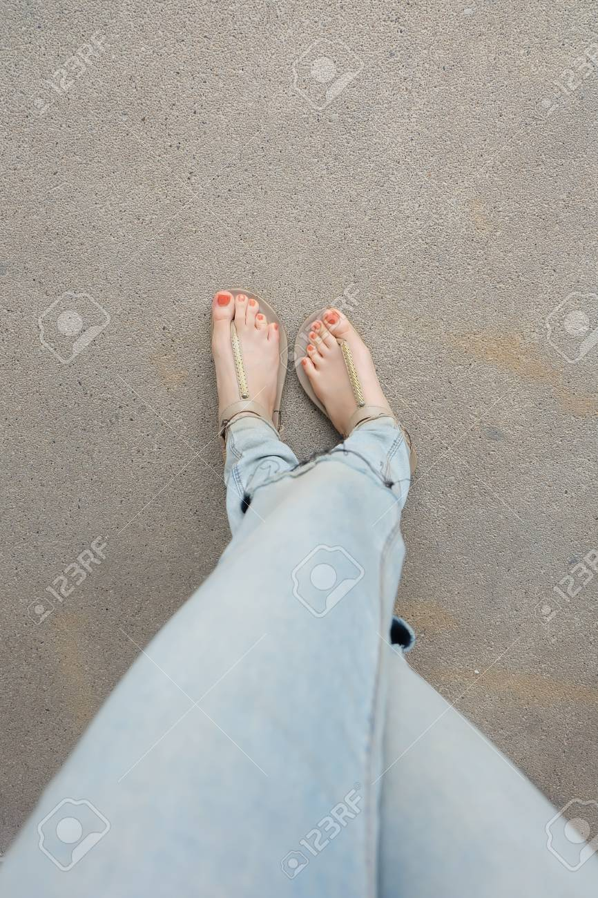 Gold Shoes (Slippers) On Girl Legs And