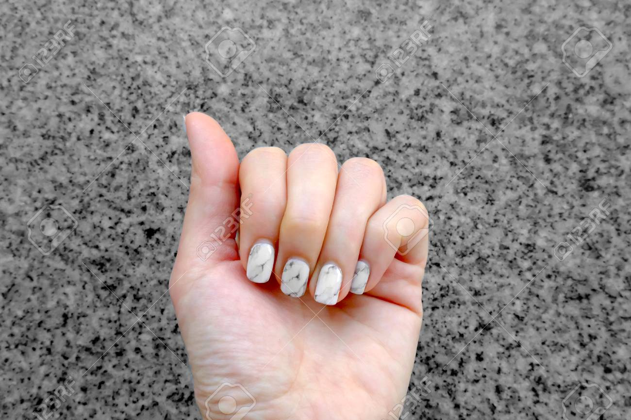 Hand And Nail Polish, Manicure Nail. Close Up Granite Gray Nails On ...