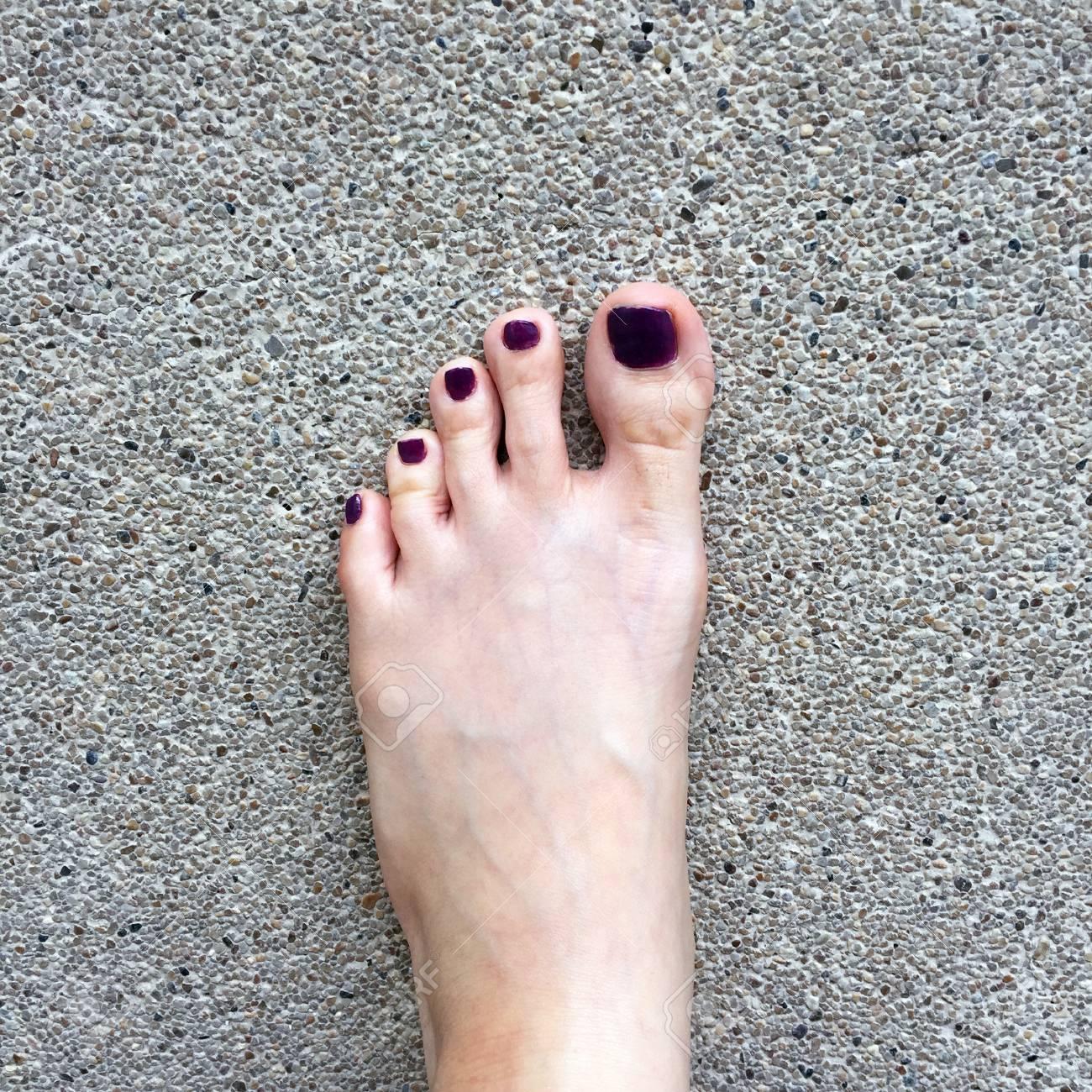 Beautiful Nail Close Up Woman S Bare Feet And Red Nail Polish