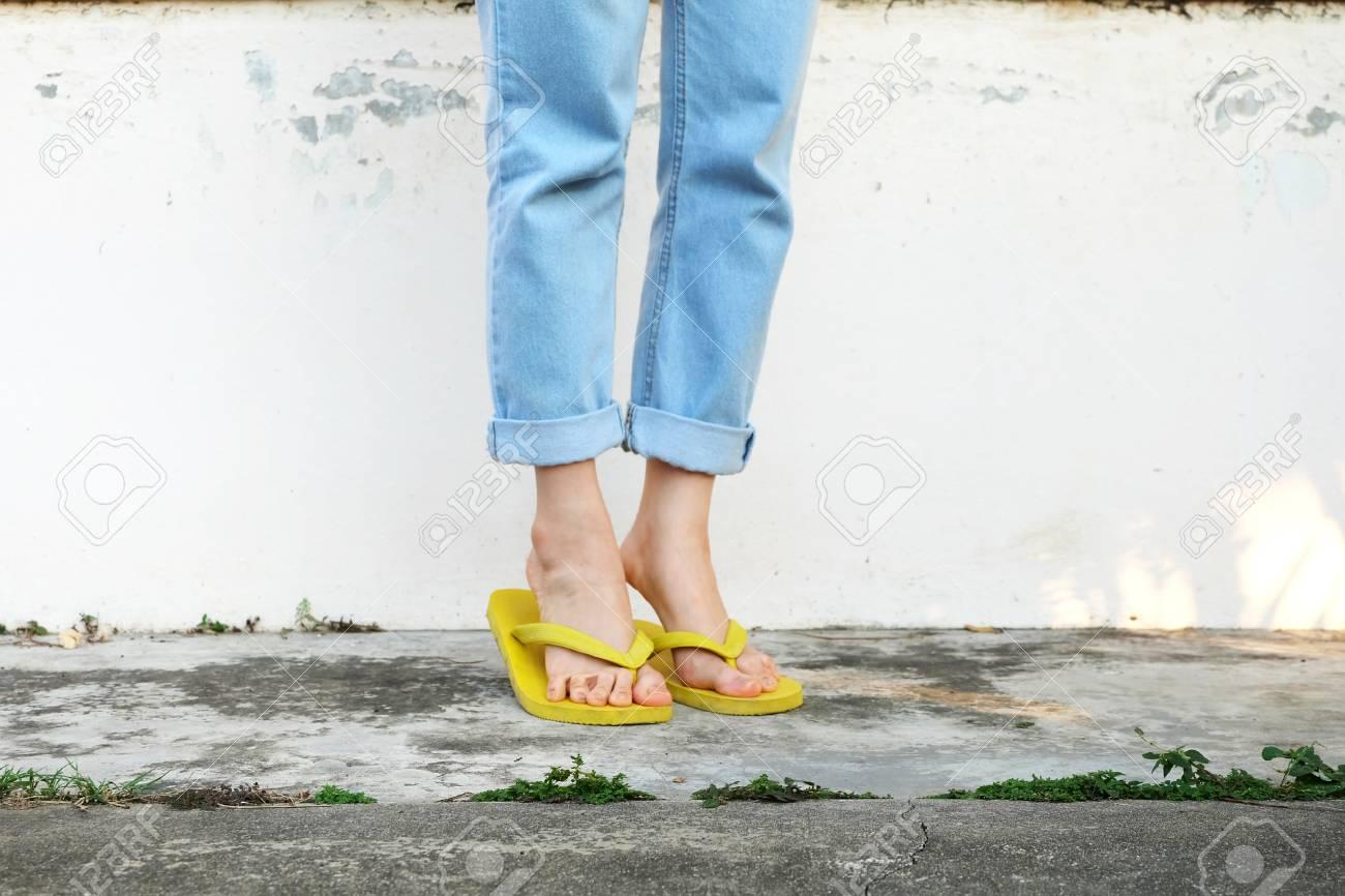 Yellow Sandals. Woman Wearing Flip