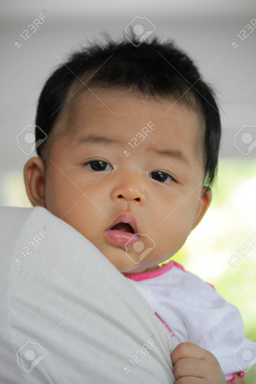 a39cfcf39a17 Close-up Shot Of Asian Baby Girl Stock Photo
