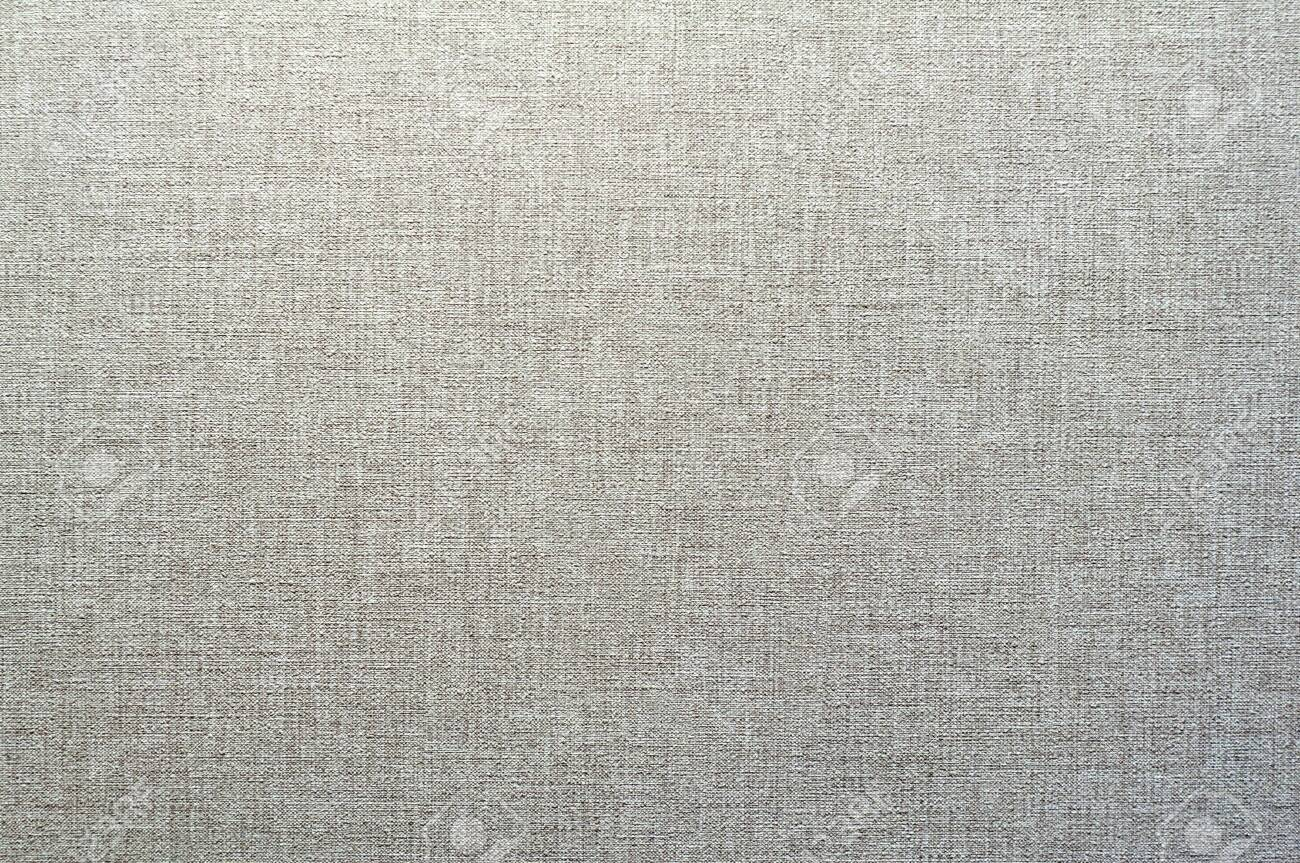 Texture of gray and white wallpaper with a stripped pattern. Gray paper surface, structure closeup. Textile wicker backdrop. - 135272647