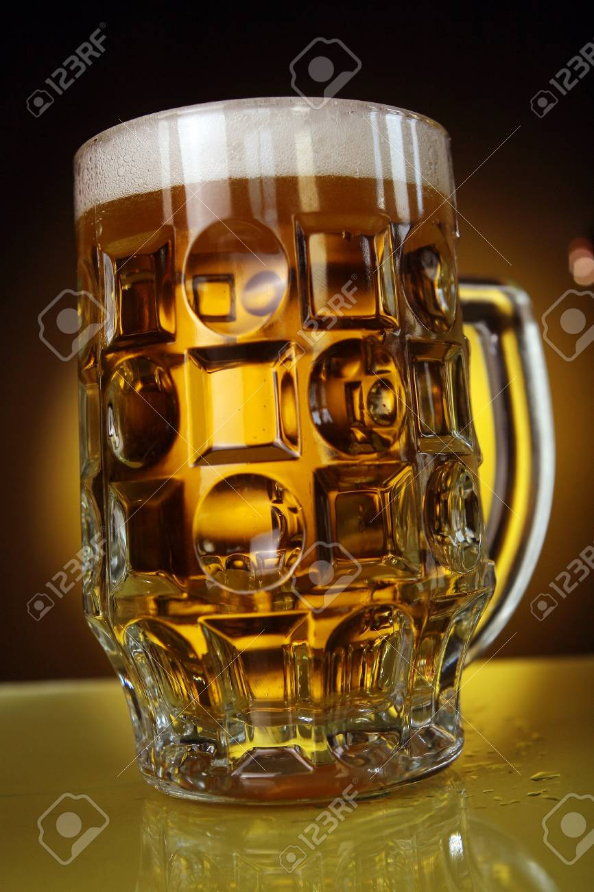 beer glass on yellow background Stock Photo - 8320642