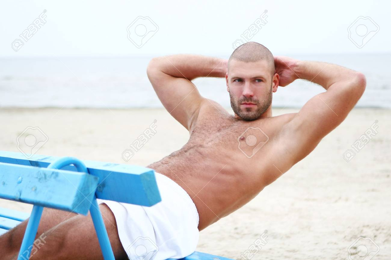 attractive and happy man on the beach Stock Photo - 8673654