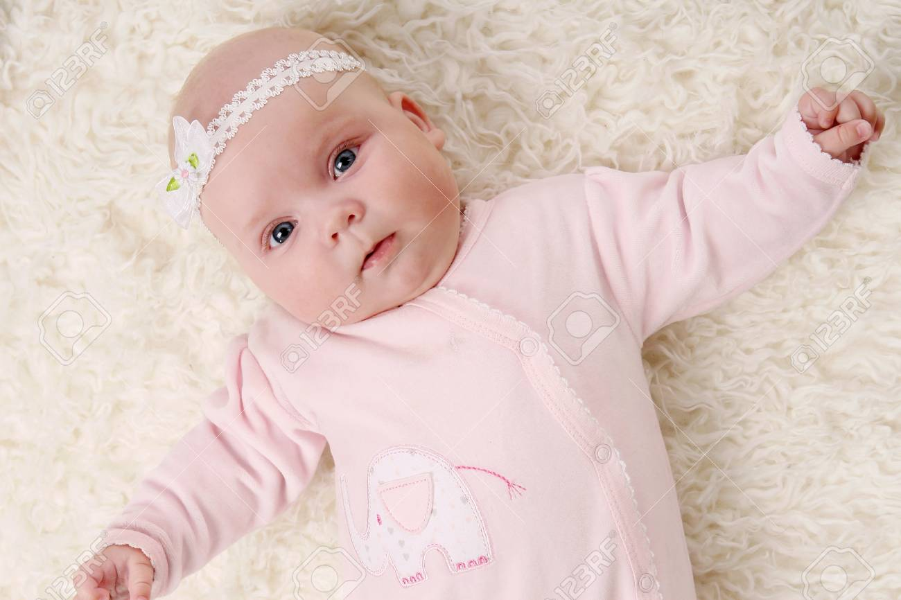 young and beautiful baby in pink Stock Photo - 8673784
