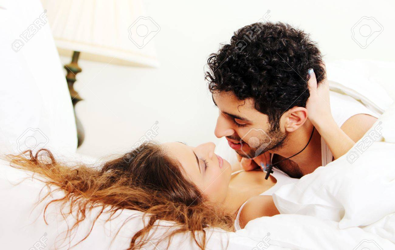 Young and beautiful couple in bed Stock Photo - 8599581