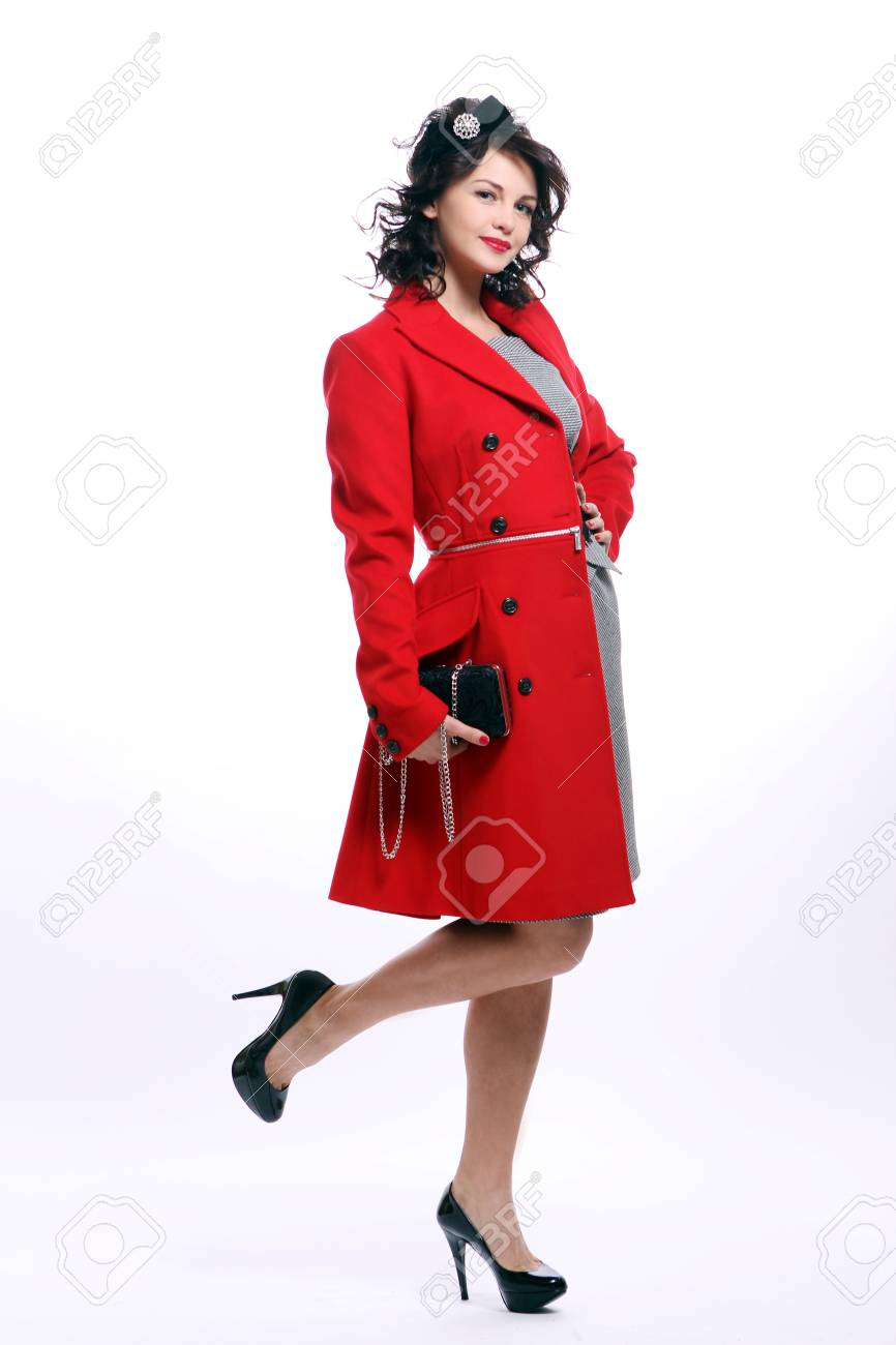 Beautiful young woman in red coat posing on white background Stock Photo - 8967950