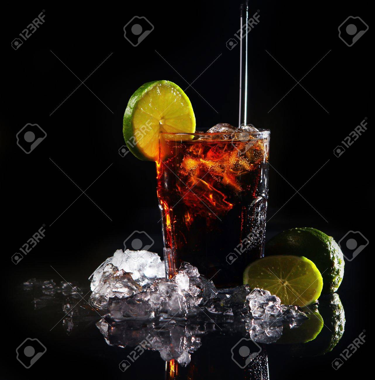 Fresh cola drink with ice and green lime on black background Stock Photo - 8936743