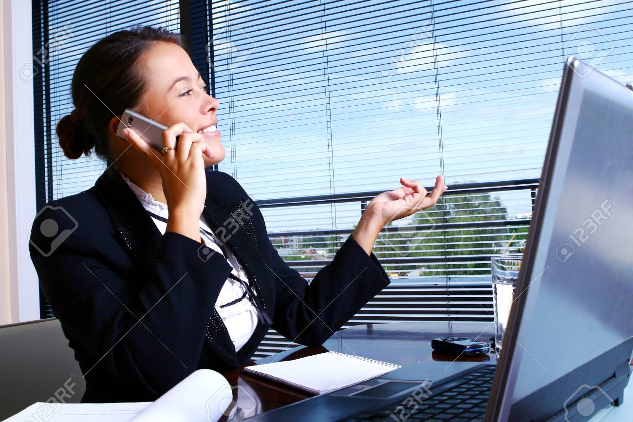 Young businesswoman working in the office Stock Photo - 9796728