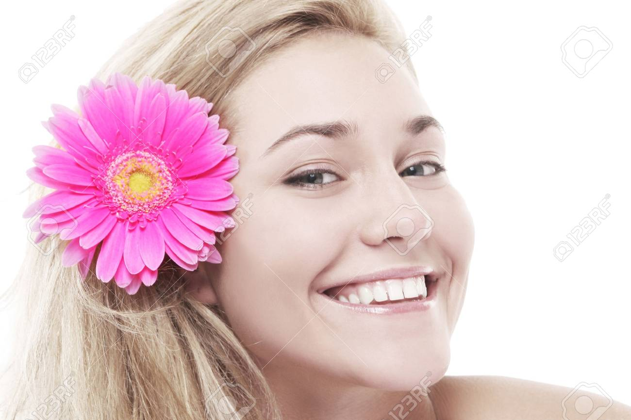 Beautiful woman with pink flower in her hairs isolated over white background Stock Photo - 9772940