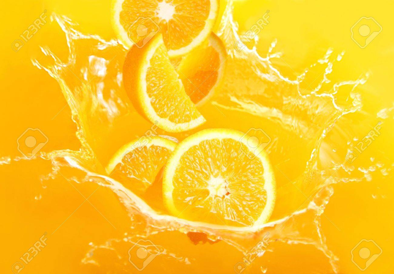 Fresh oranges falling in juice with lot of huge splashes Stock Photo - 9860587