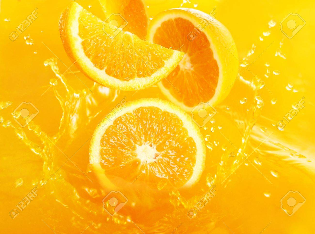Fresh oranges falling in juice with lot of huge splashes Stock Photo - 9885331