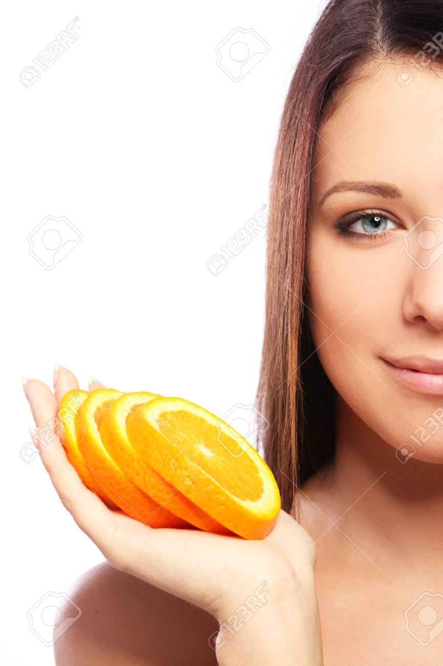 Beautiful woman with orange in hands against white background Stock Photo - 10787248