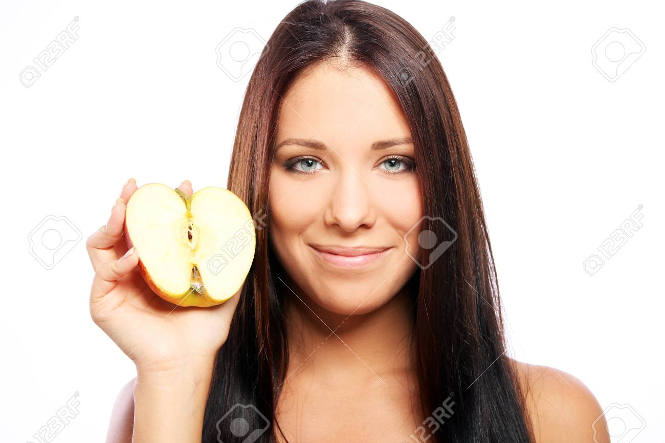 Beautiful woman with apple in hands against white background Stock Photo - 10787253