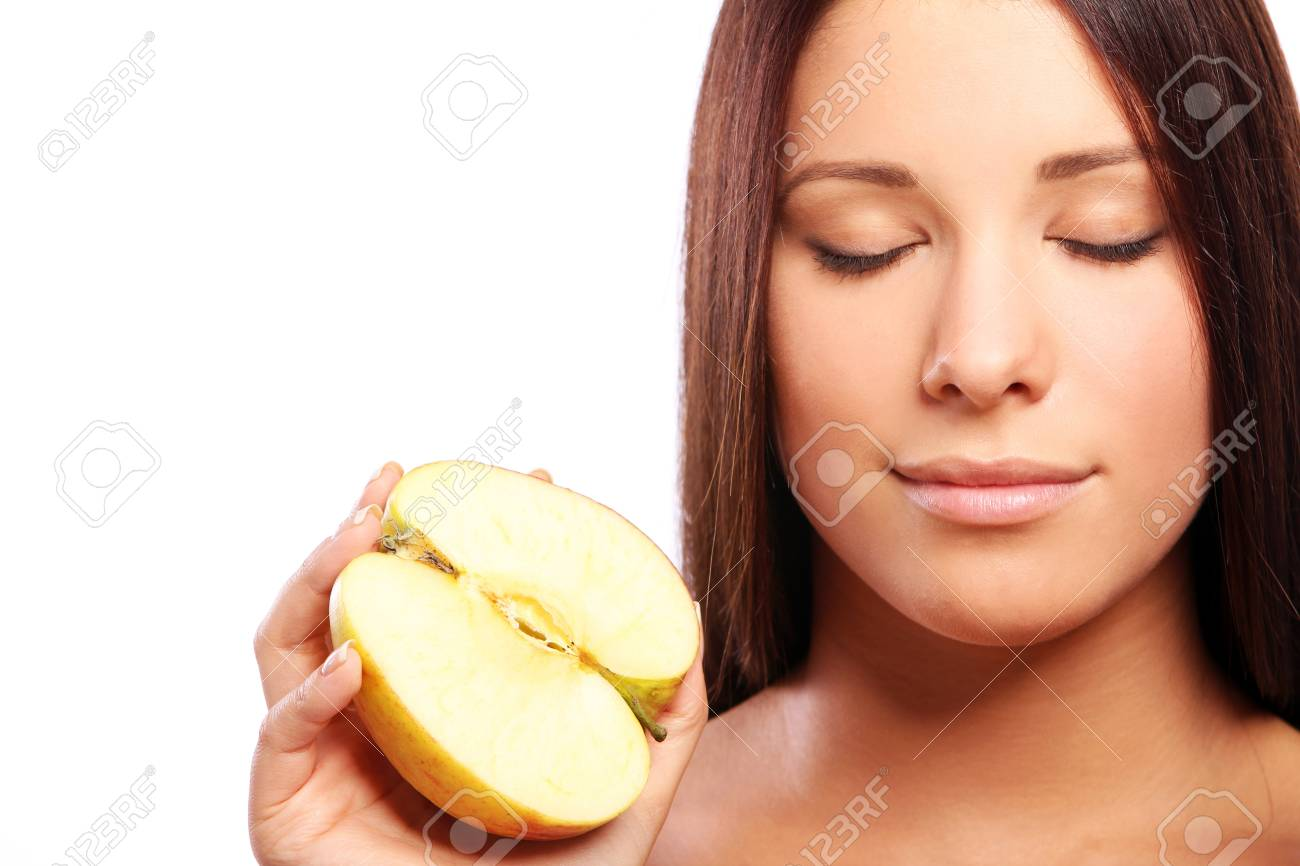 Beautiful woman with apple in hands against white background Stock Photo - 10756170