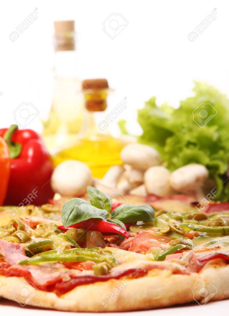 Fresh and tasty pizza on kitchen table Stock Photo - 10883389