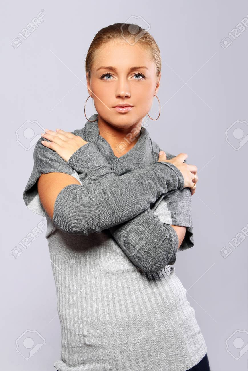 Beautiful sexy woman in pullover posing over gray background Stock Photo - 10952856