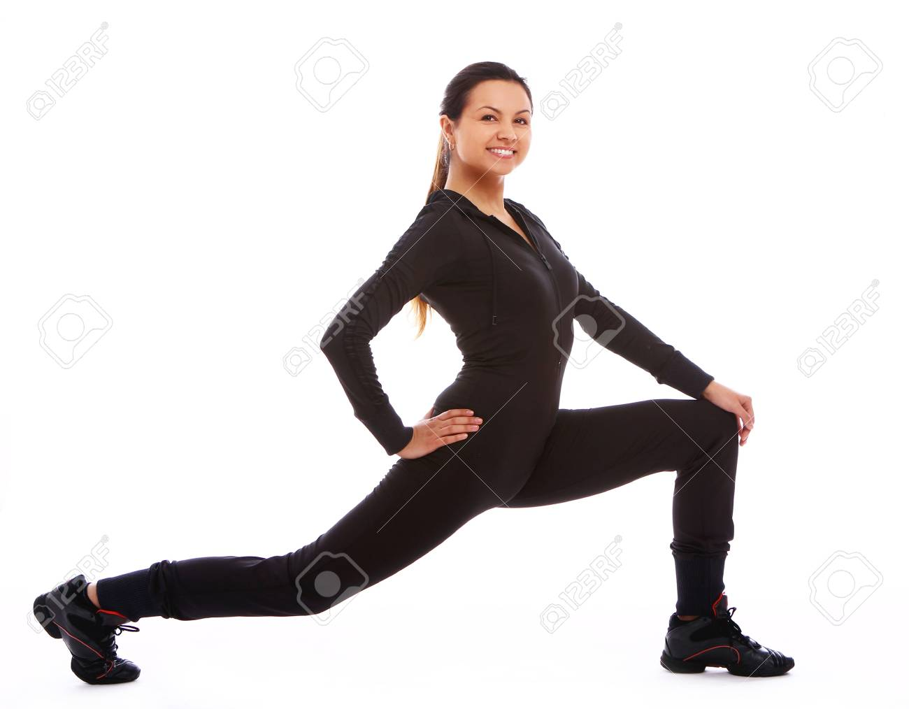 Beautiful and happy woman doing fitness exercises isolated over white Stock Photo - 10952686