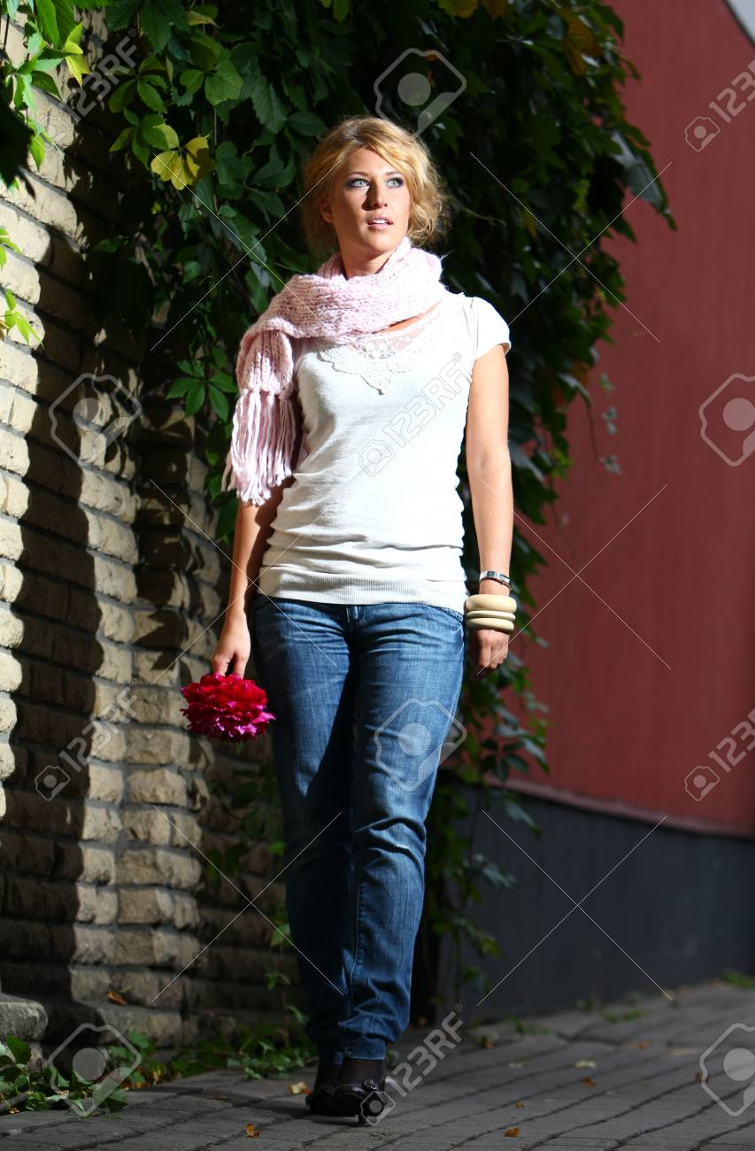 Young woman beside a brick wall on the city street Stock Photo - 12009900