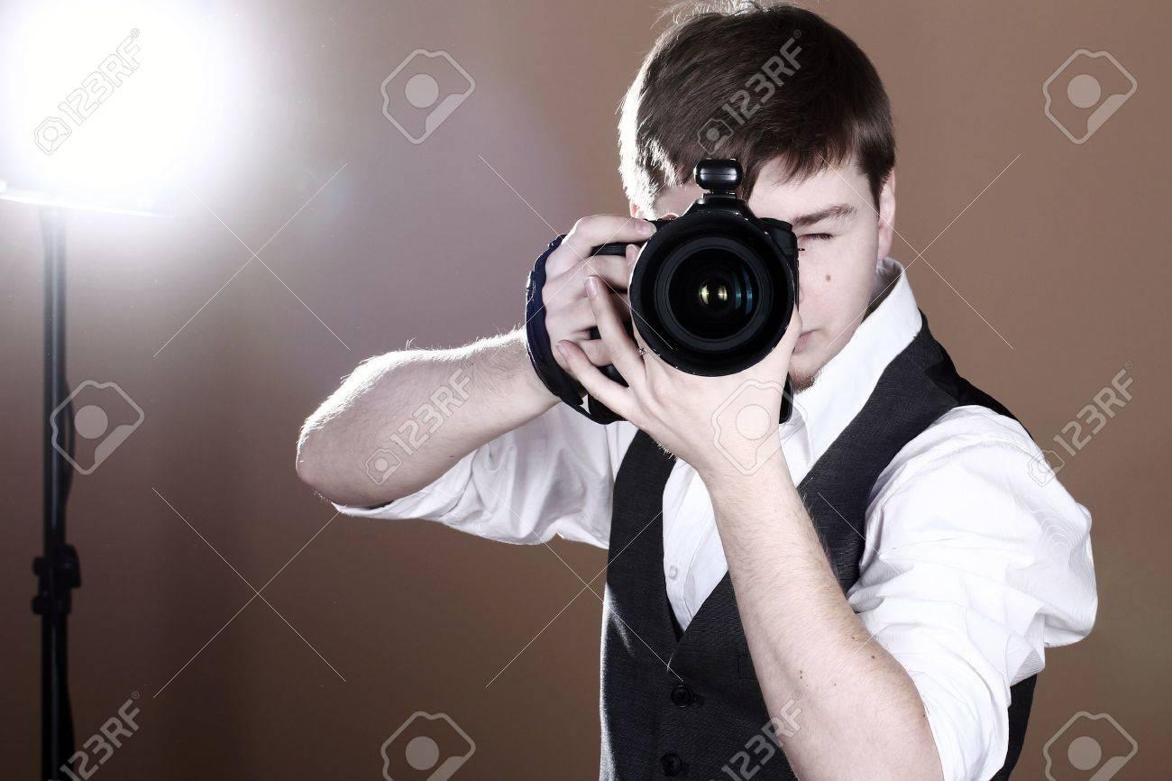 Photographer with camera in studio Stock Photo - 12189763