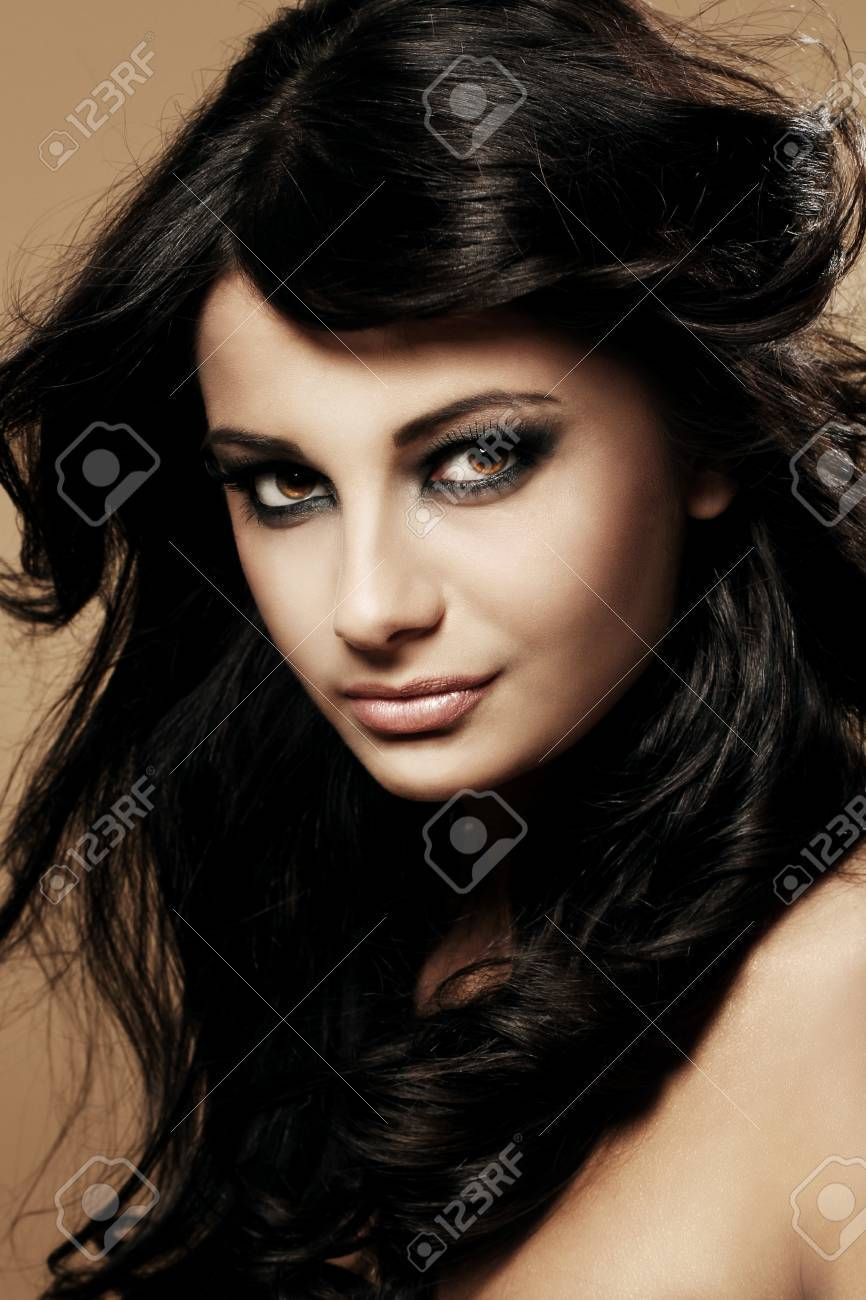Portrait of young and beautiful brunette Stock Photo - 12767630