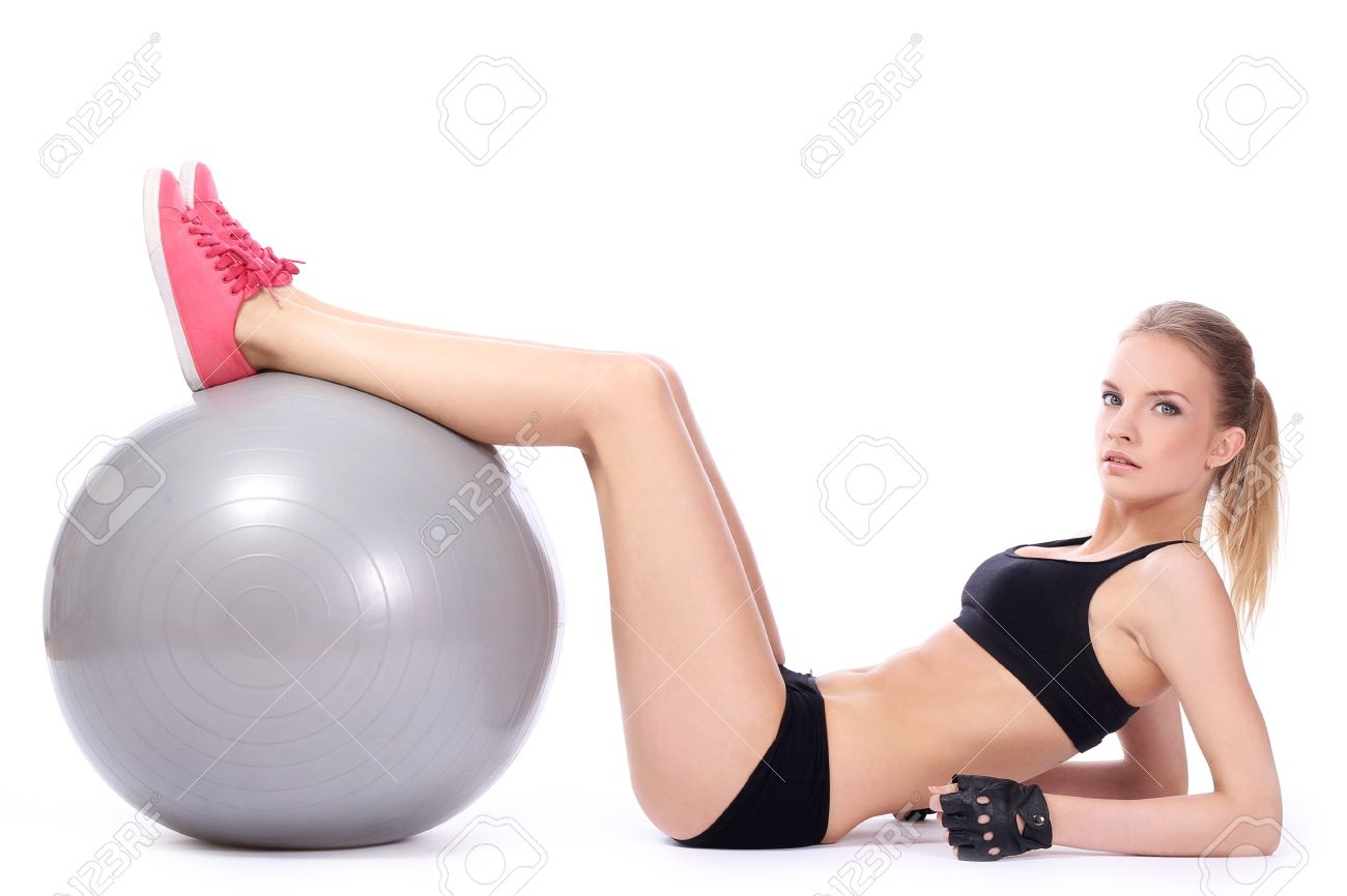 Beautiful woman doing abs exercises with fitness ball over white background Stock Photo - 14361820