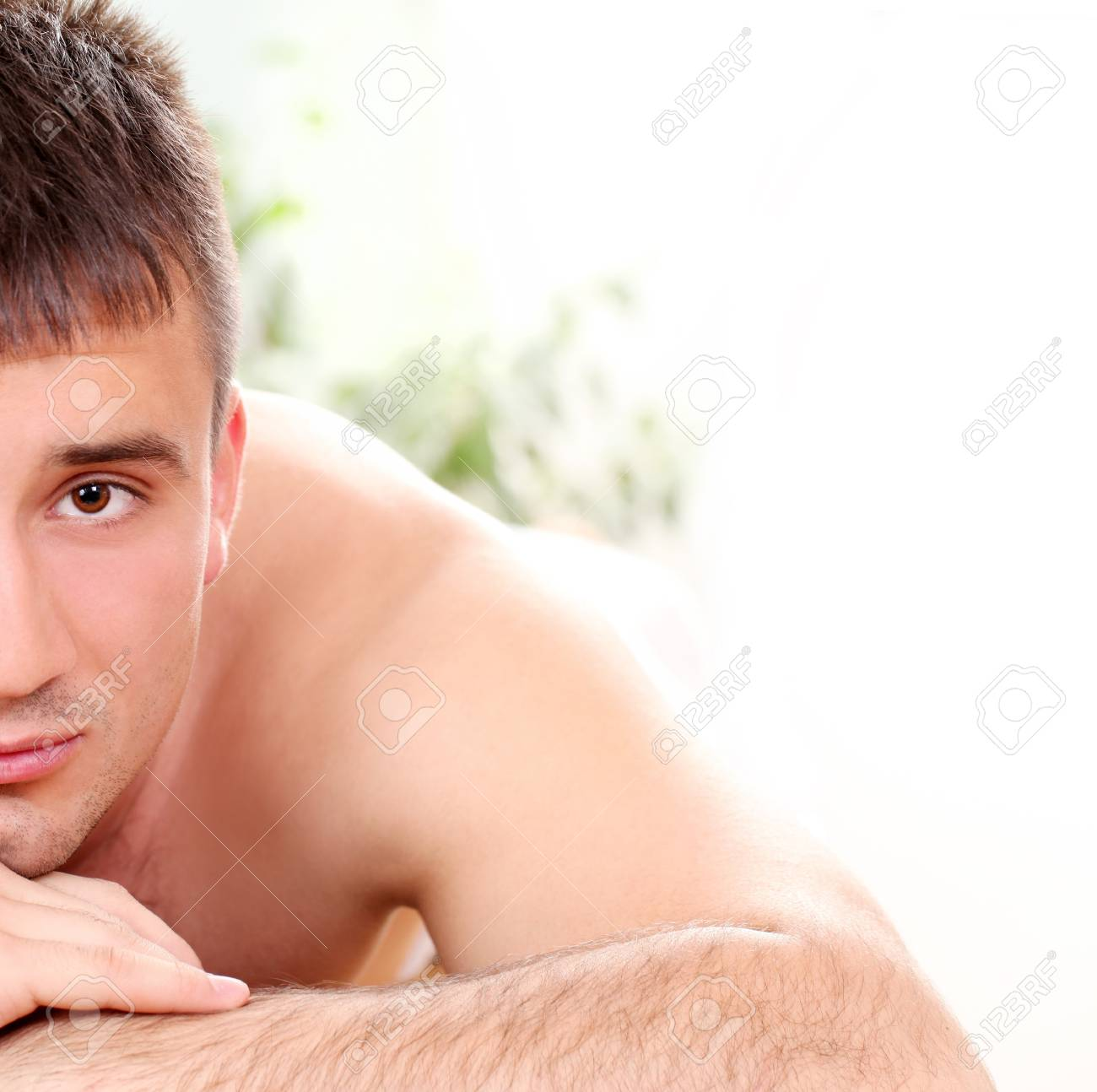 Handsome man relaxing and enjoying procedure of massage Stock Photo - 14362938