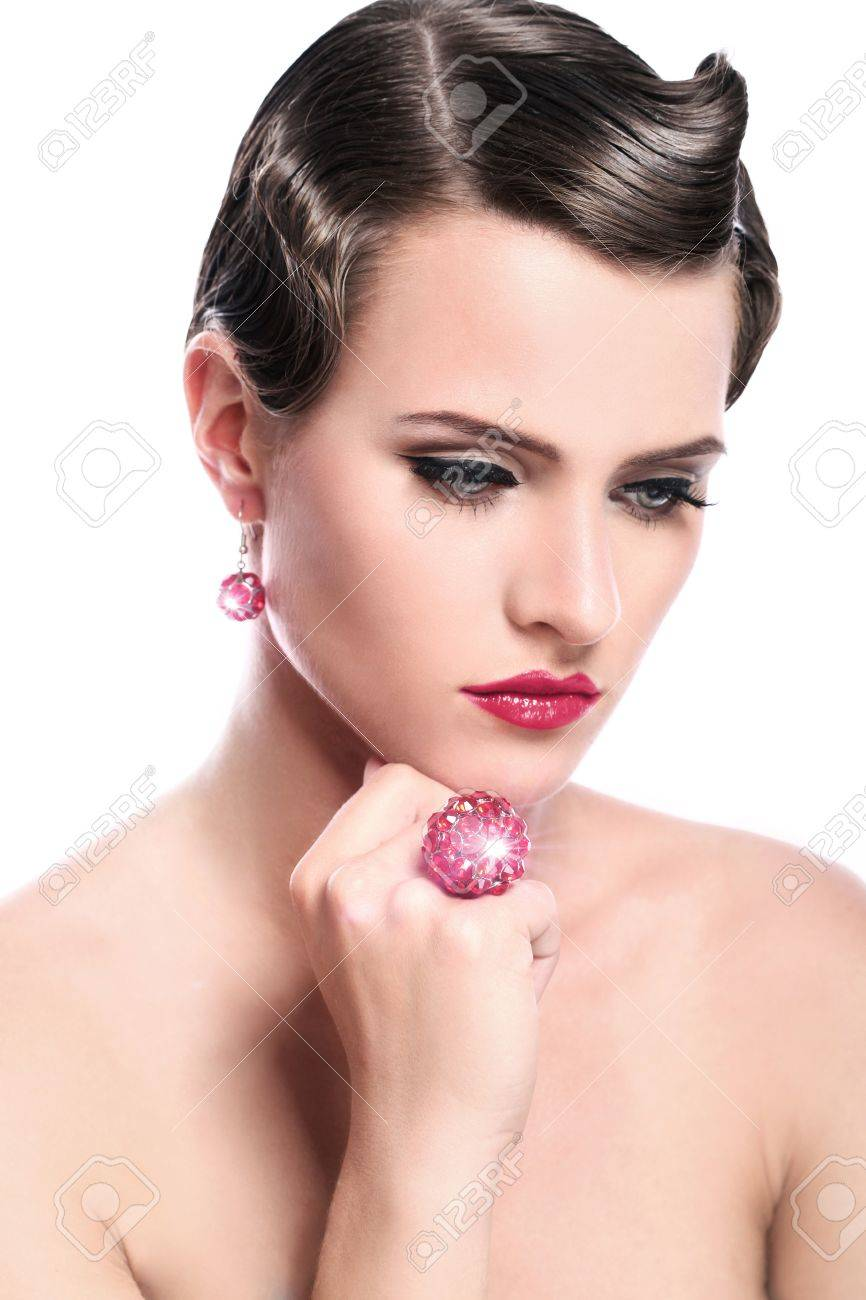 Young and beautiful woman with red jewelry over white background Stock Photo - 14520080