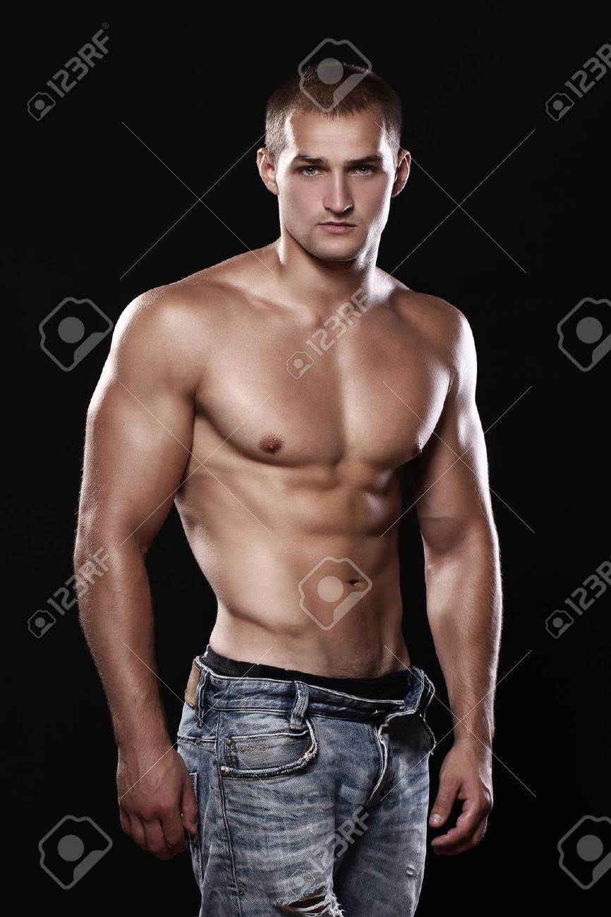 Young And Sexy Guy Wearing Jeans Over Black Background Stock Photo ...