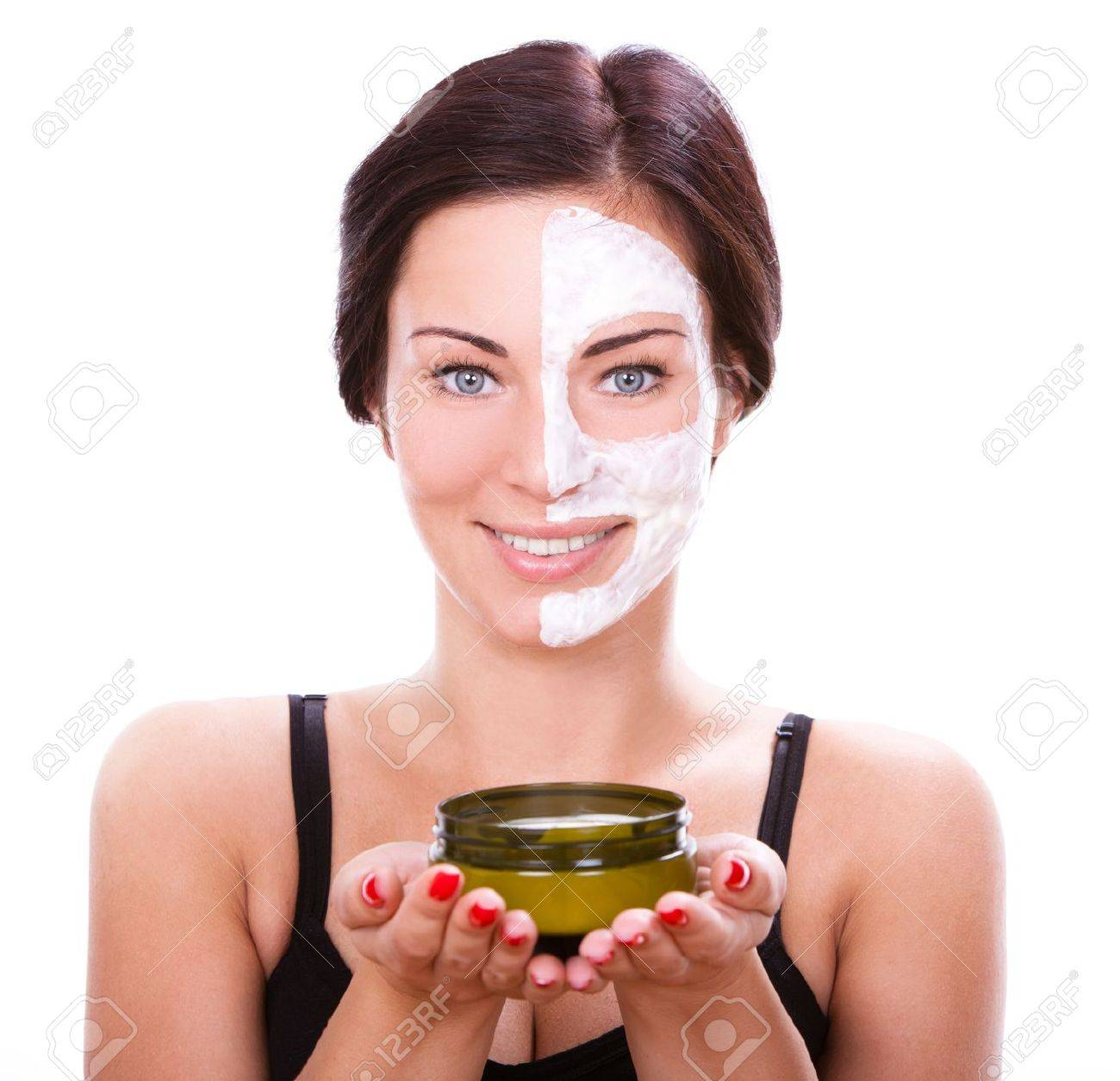 Beautiful woman  with facial mask over white background Stock Photo - 15946527