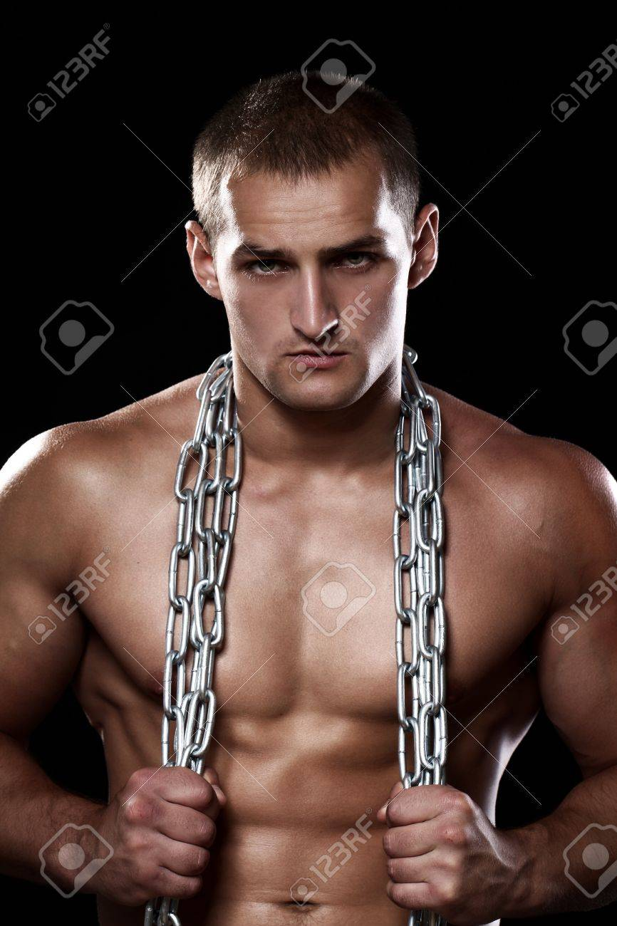 Handsome and muscular guy with chains over his body Stock Photo - 15949518