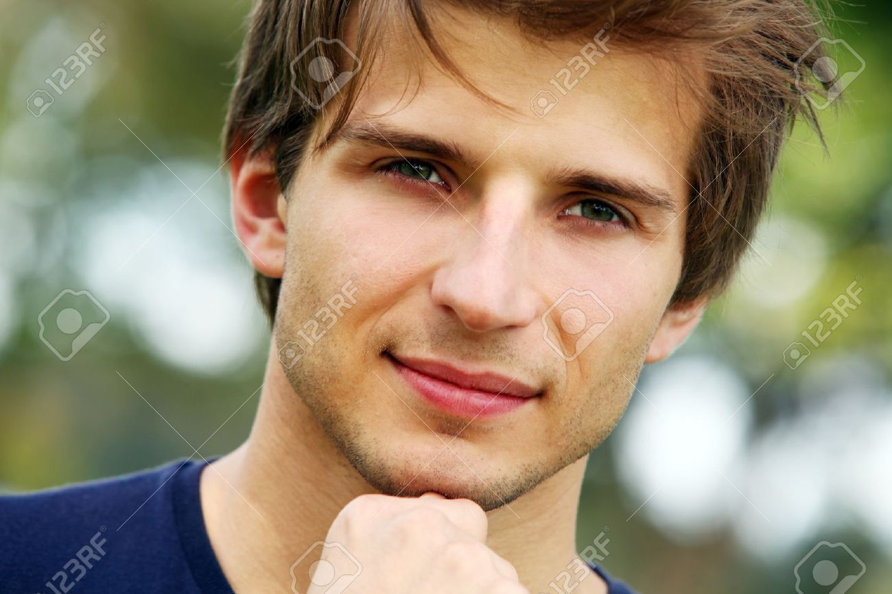 Portrait of young and smiling cute man in park Stock Photo - 16227609
