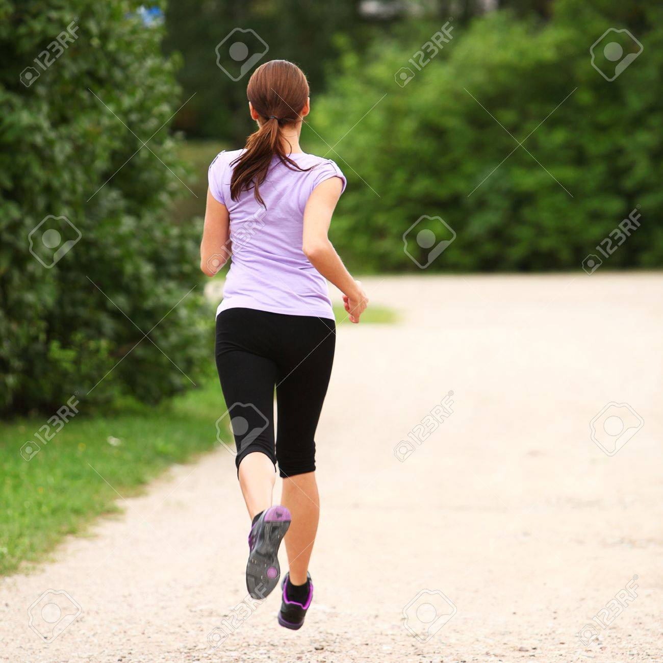 Young and attractive sporty girl running in the park Stock Photo - 16749218