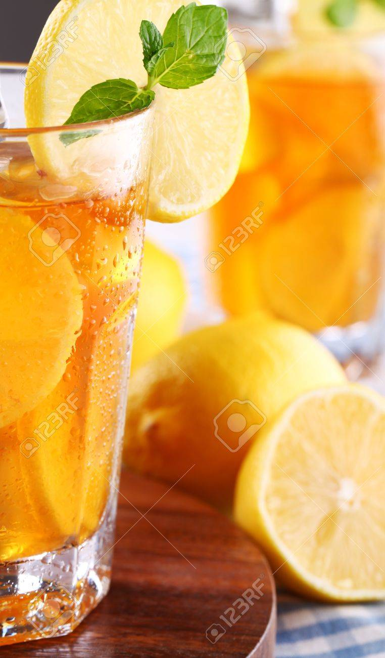 Close up of fresh and cold ice tea with sliced lemon and mint Stock Photo - 16819712